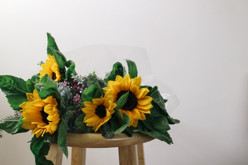 Sunflower bouquet on a wooden chair