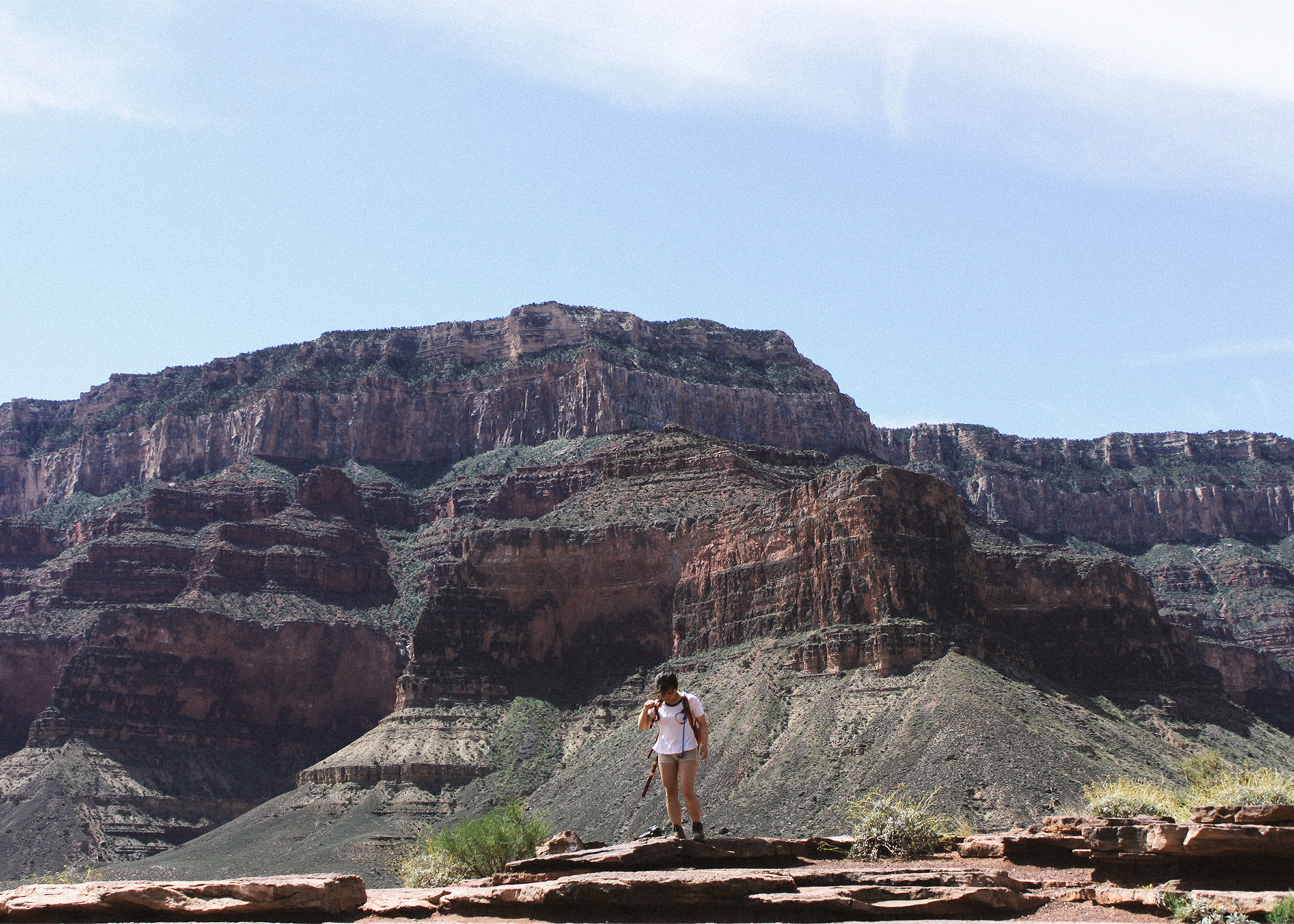 Jennifer standing with the red rocks in the background.