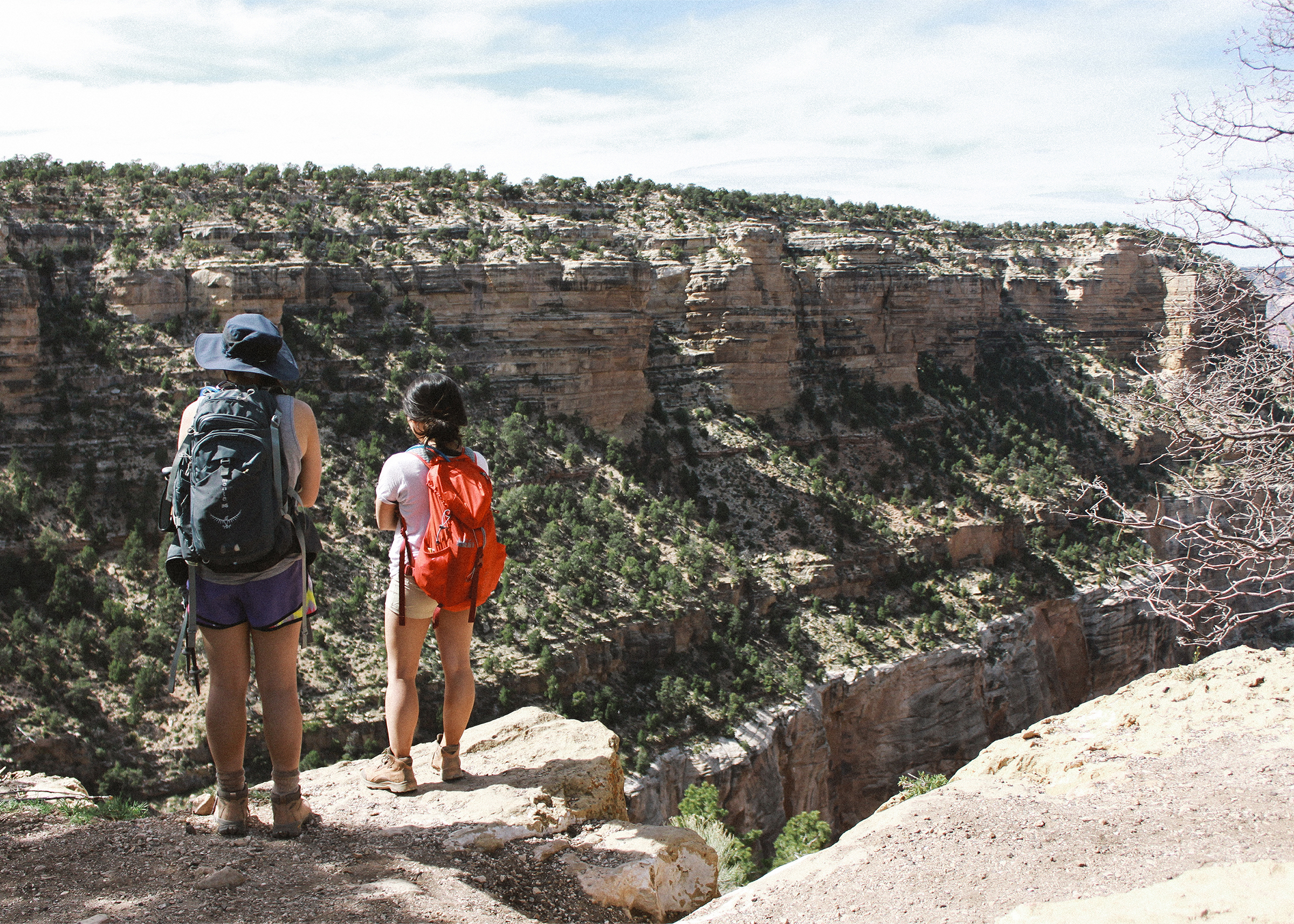 Vivian and Jennifer standing at the trailhead of the Bright Angel Trail