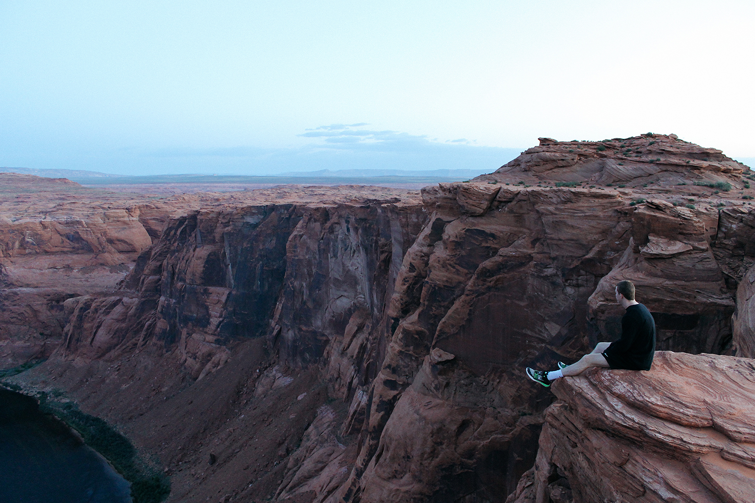 A person sitting at Horseshoe Bend.