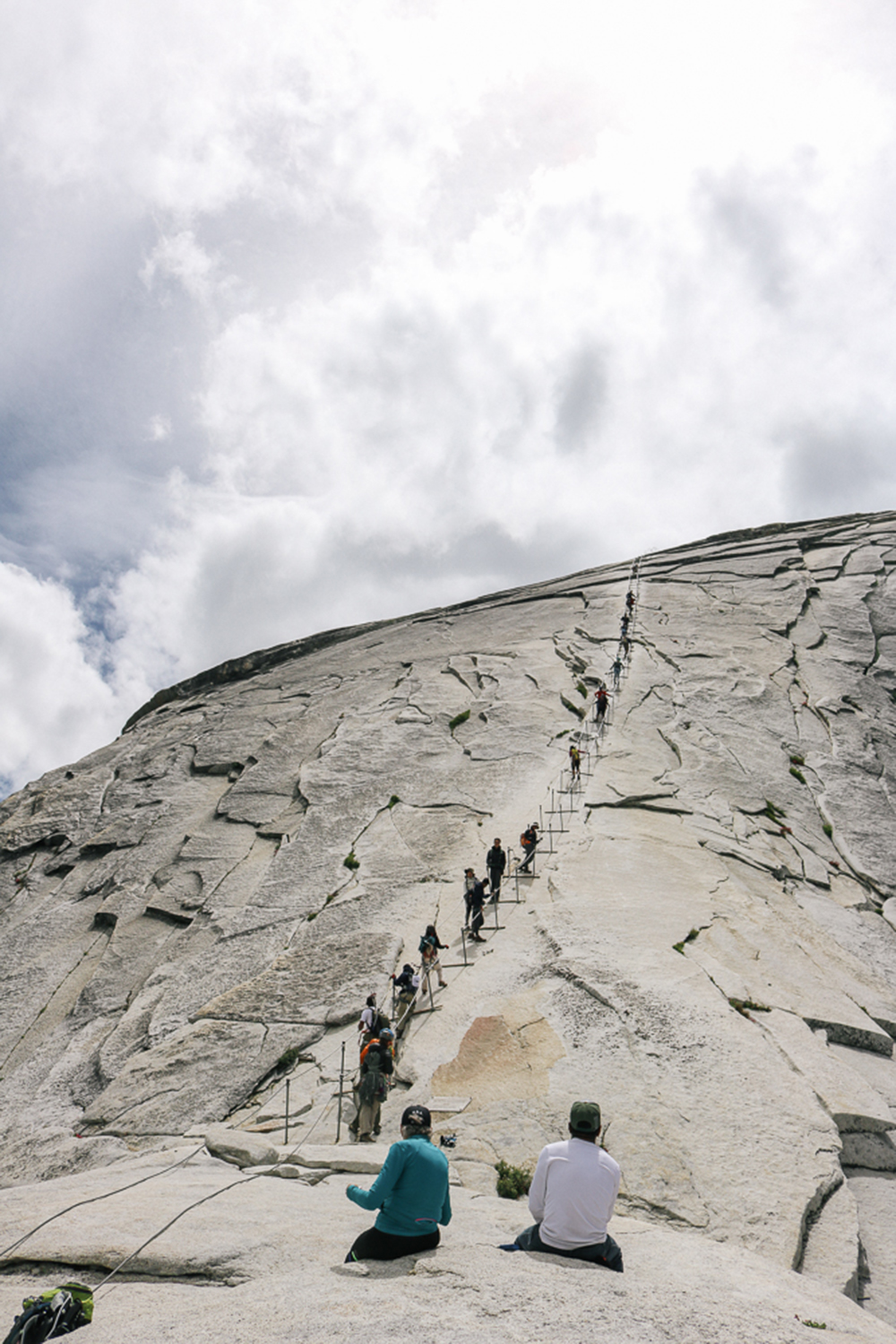 watching brave hikers climb up from the bottom of Half Dome