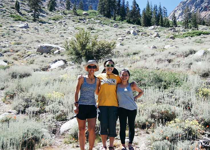 Tamara, Vivian, and Jennifer smiling happily after a great backpacking trip