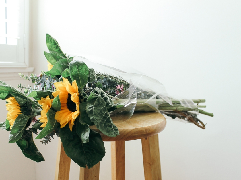 Sunflower bouquet on a wooden chair