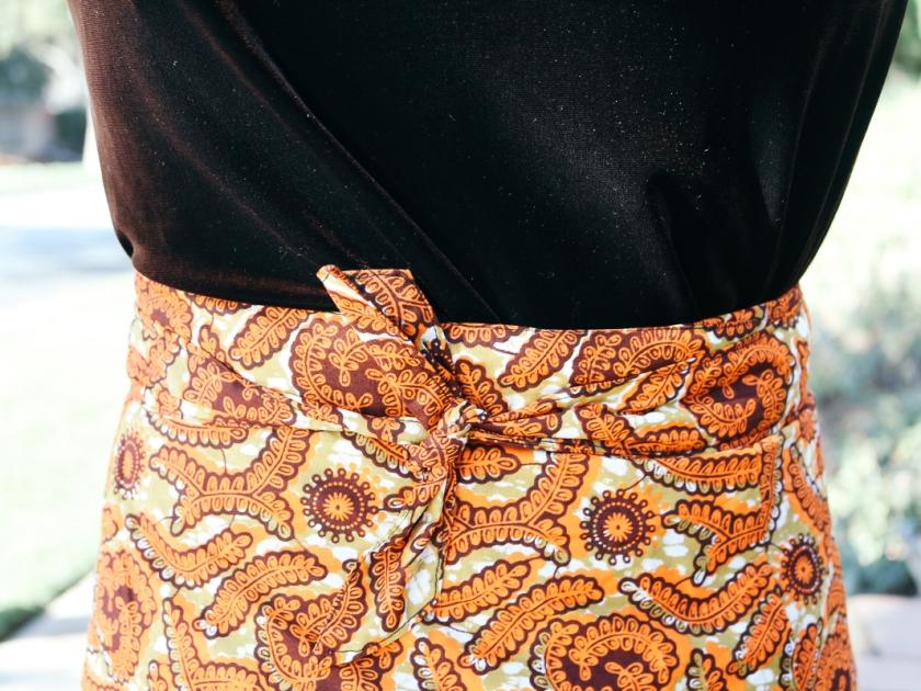 Vivian in a velvet top and knee length wrap skirt.