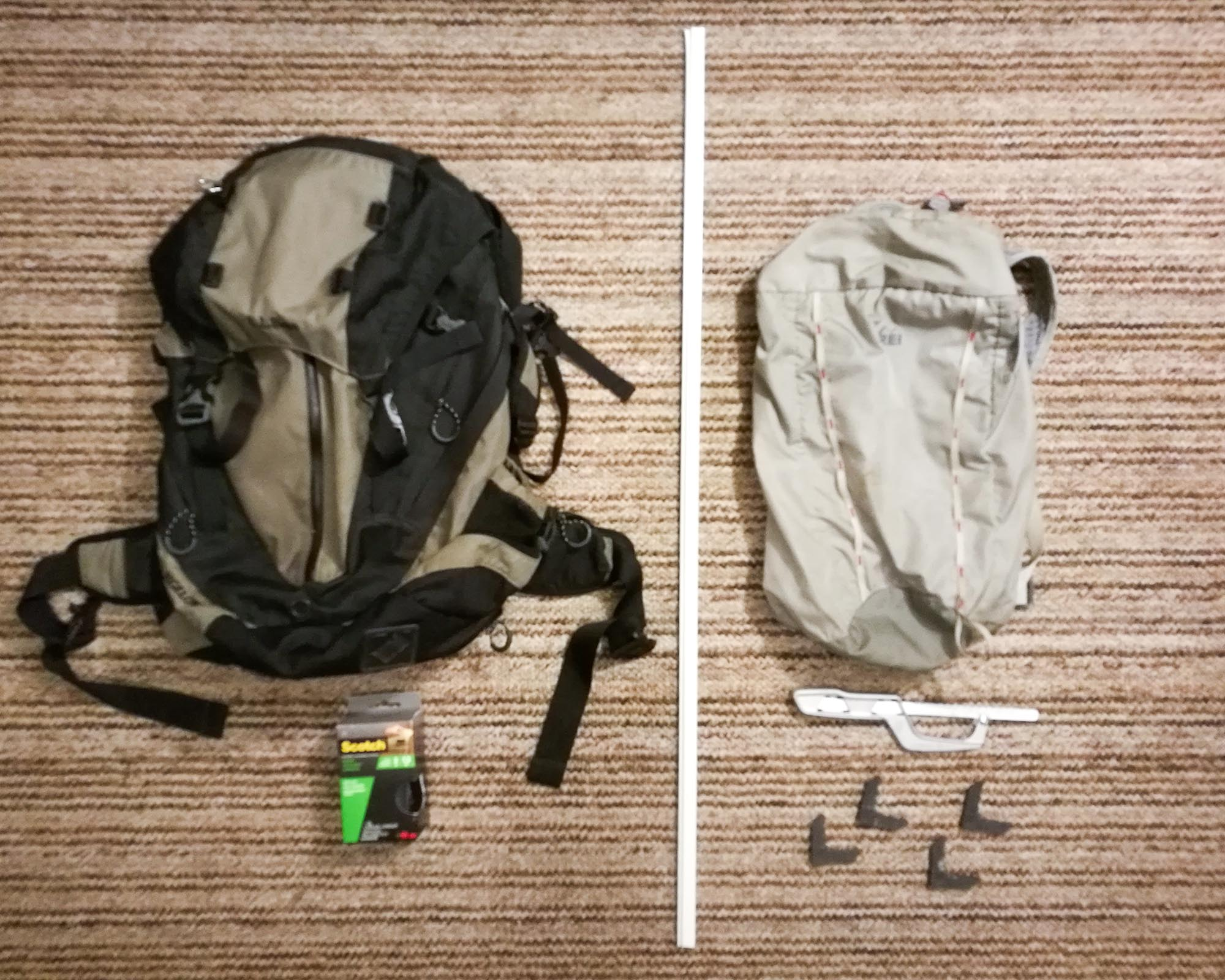 Photo of materials: LL Bean 27L Daypack for hip belt, roll of velcro, frame, REI 18L Flash Pack, metal handsaw, and frame connectors