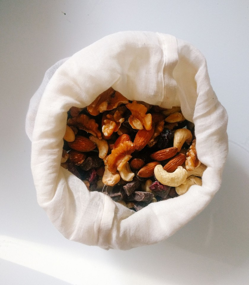 Photo of trail mix in reusable produce bag