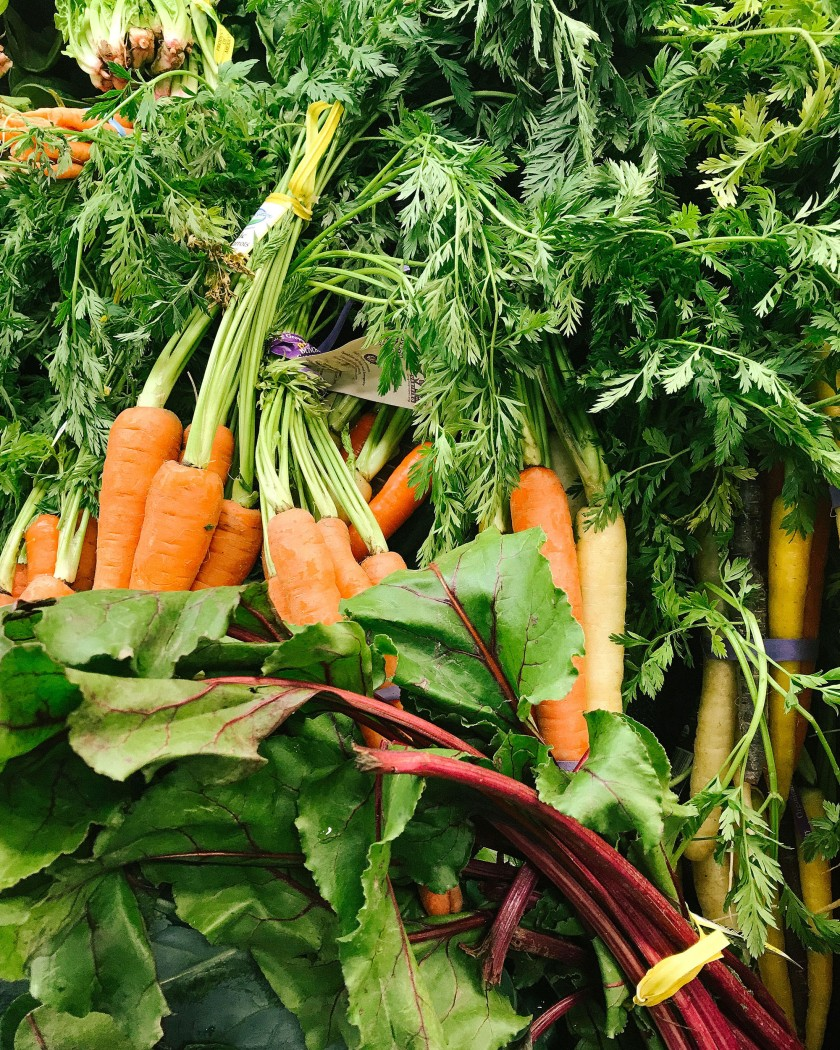 Photo of carrots and leafy greens