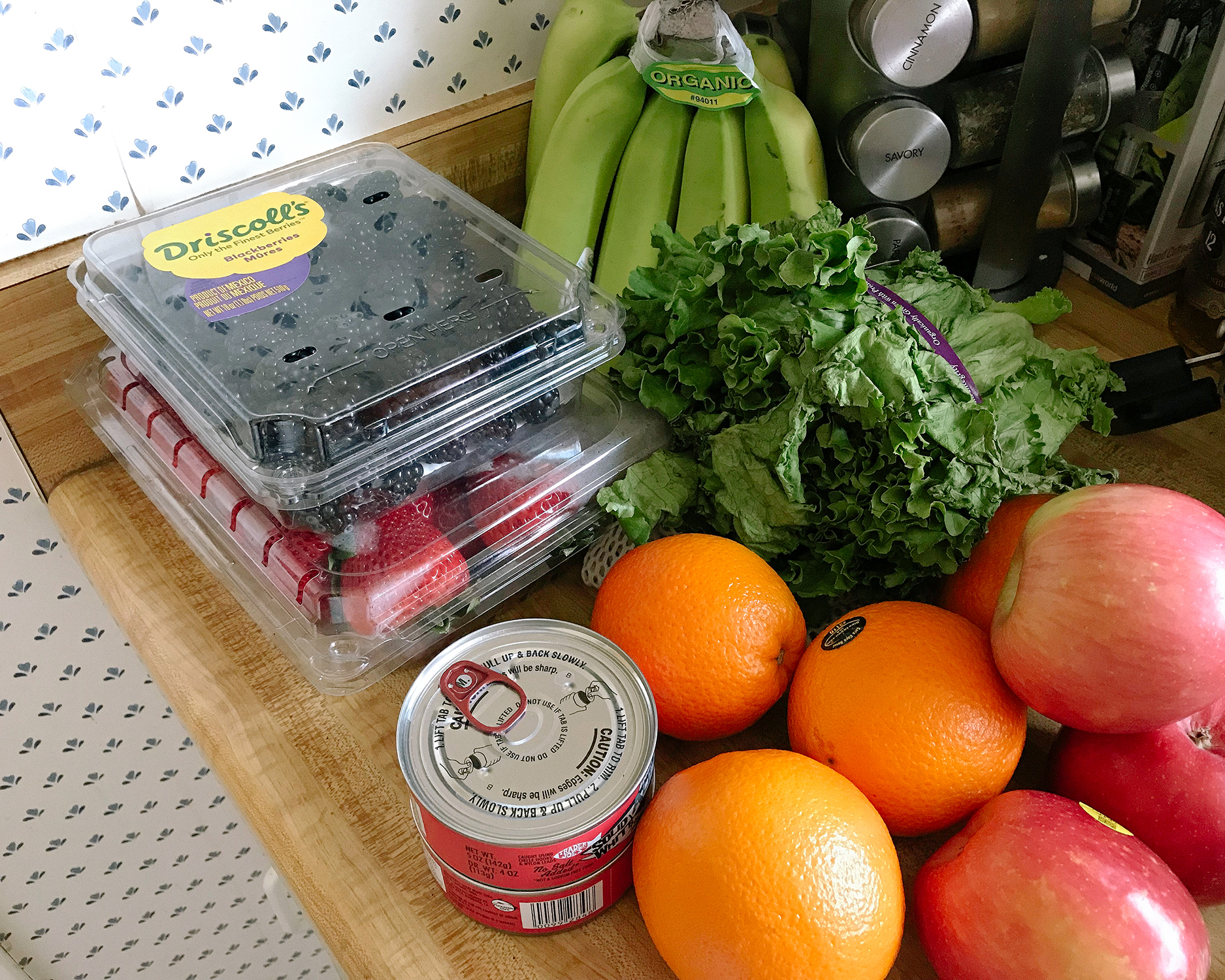 Photo of my grocery for the week: fruits, veggies, and a tuna can