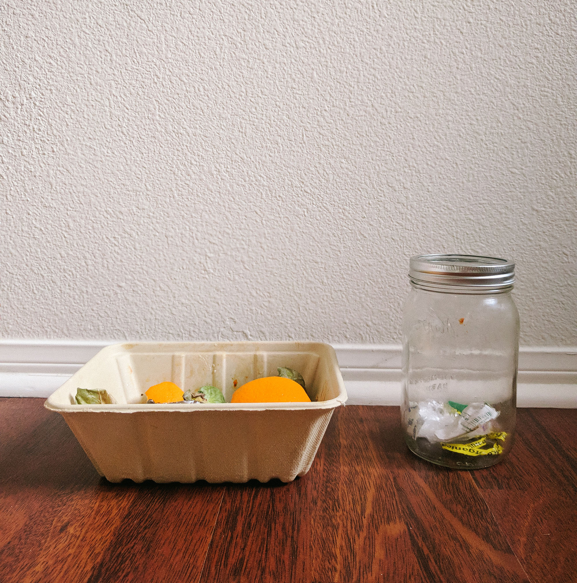 mason jar with waste and compost pile day 1