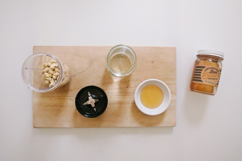Cover Photo of cashews, water, and honey to make cashew milk