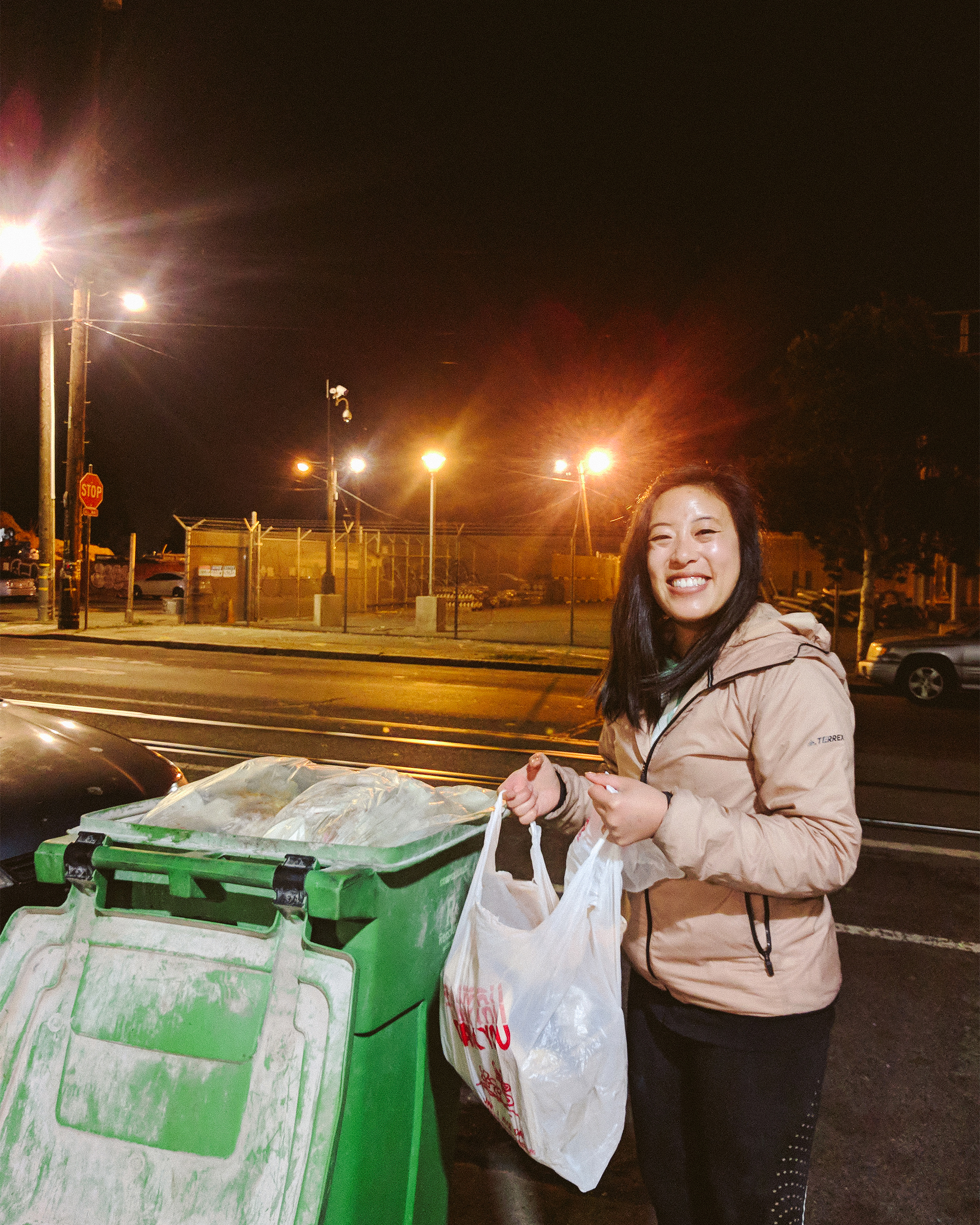 Photo of Vivian with food waste in plastic bag