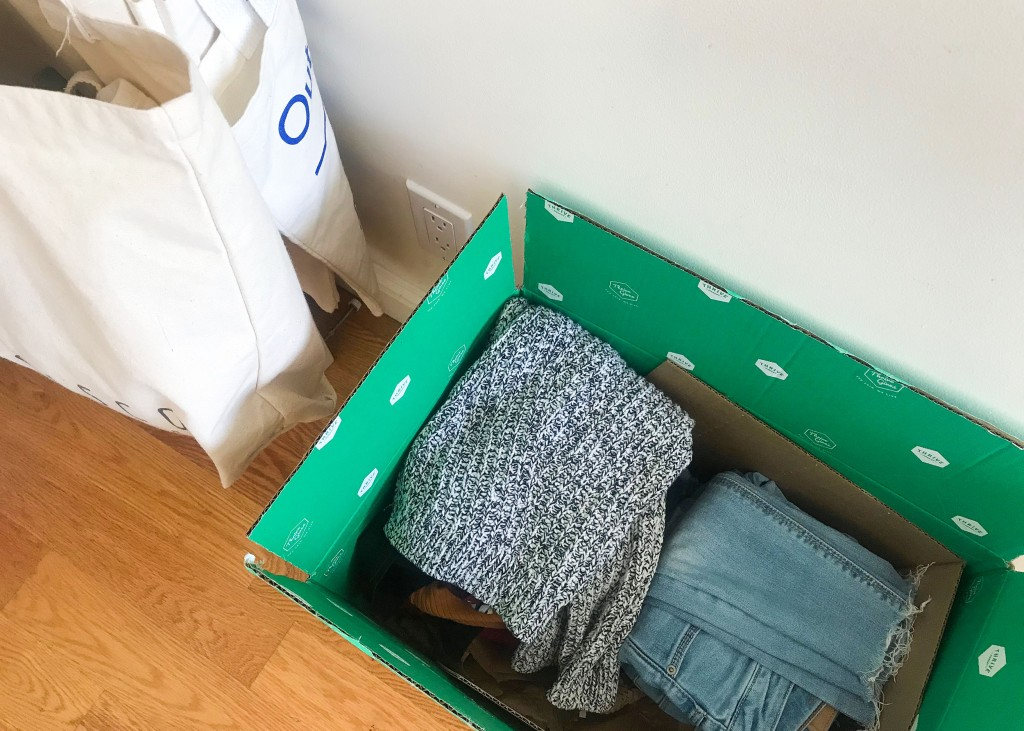 a box of used clothes ready to be sold and donated